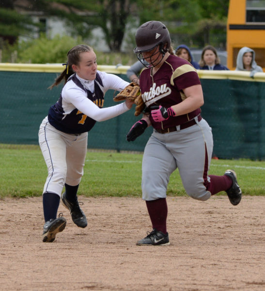 Kayla Donlin tags out Taylor Devoe, then through to first to complete a double play in the fourth inning. (Paula Roberts photo)