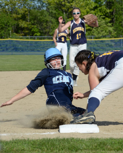 Lady Panther Hallie Kunesh tags out Mariner Lauren Hatch at third. (Paula Roberts photo)