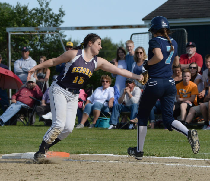 Medomak Valley first baseman Lydia Simmons takes out Oceanside'sAbby Veilleux. (Paula Roberts photo)