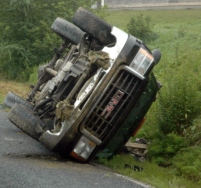 A GMC pickup rests on its side after a rollover in Bremen the morning of Tuesday, July 18. (Alexander Violo photo)