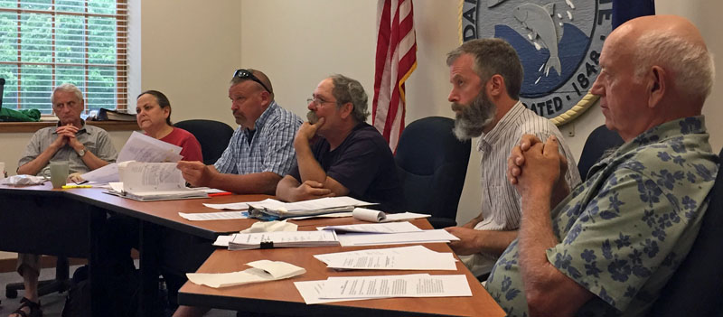 From left: Damariscotta Town Planner Tony Dater and Damariscotta Planning Board members Shari Sage, Neil Genthner, Jonathan Eaton, Adam Maltese, and Wilder Hunt listen to a presentation from representatives of the Dollar General project. (Maia Zewert photo)