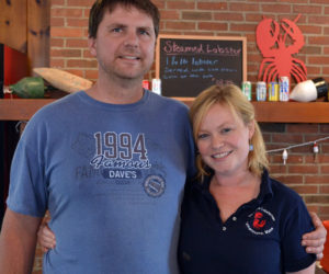 Joe Lane Lobsterman co-owners Joe Lane and Izzy Nelson behind the counter of their restaurant Friday, July 7. The restaurant opened at 115 Elm St. in Damariscotta at the end of June. (Maia Zewert photo)