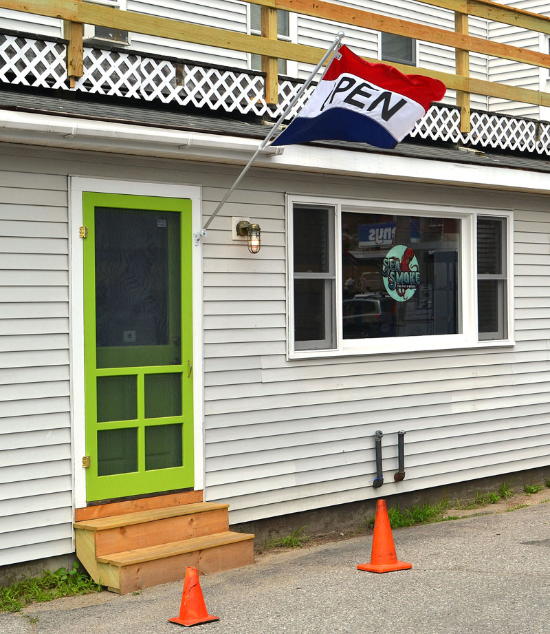 The entrance to Sea Smoke Shop at the side of 95 Main St. in downtown Damariscotta, next to the Colby & Gale Inc. service station. (Maia Zewert photo)
