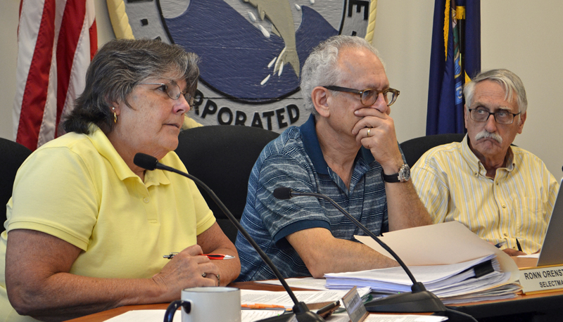 From left: Damariscotta Board of Selectmen Chair Robin Mayer speaks during a public hearing about recreational marijuana at the town office Wednesday, July 19 as Selectmen Ronn Orenstein and George Parker look on. (Maia Zewert photo)