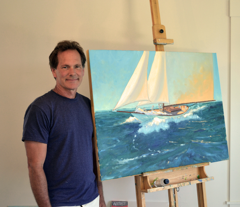 Brad Betts stands with one of his paintings, a work in progress, at Down East Gallery, which celebrated its grand opening in Edgecomb on July 1. (Abigail Adams photo)
