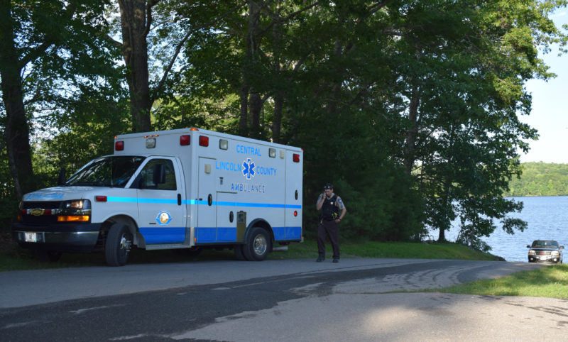 An ambulance waits at the public boat ramp on Damariscotta Lake in Jefferson on Sunday, July 9. The Maine Warden Service is investigating a fatality on the lake.