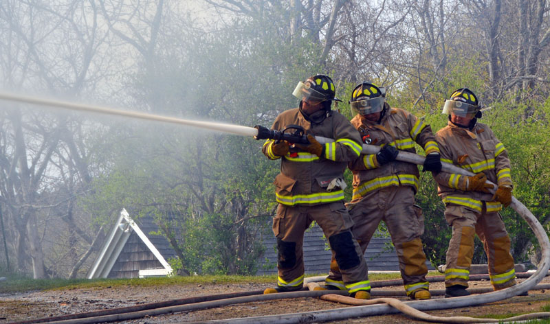 Alna firefighters work on the scene of a house fire at 38 South Dyer Neck Road in Newcastle in May 2016. The Lincoln County Fire Chiefs Association is developing a firefighter strike team to assist with major events. (Maia Zewert photo, LCN file)