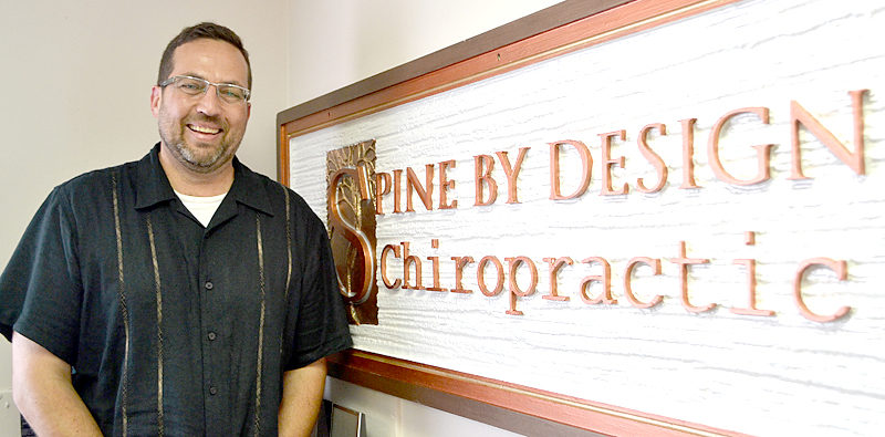 Dr. Thomas White in the Spine by Design office at 19 Sheepscot Road in Newcastle on opening day, Friday, July 14. (Maia Zewert photo)