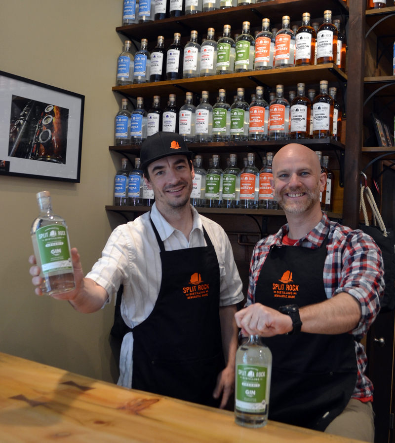 Split Rock Distilling founders Topher Mallory (left) and Matt Page hold the first two bottles of the distillery's gin. The spirit made its official debut Saturday, July 1, on the one-year anniversary of the business's opening. (Maia Zewert photo)