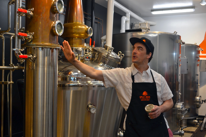 Split Rock Distilling co-founder Topher Mallory leads a tour during the distillery's one-year anniversary celebration Saturday, July 1. (Maia Zewert photo)