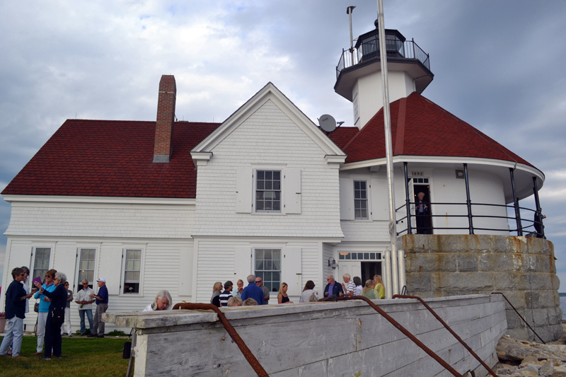 Guests at a fundraiser at Cuckolds Lighthouse on Wednesday, July 10 enjoy a rare glimpse of the results of a decade-long reconstruction and preservation effort. (Abigail Adams photo)