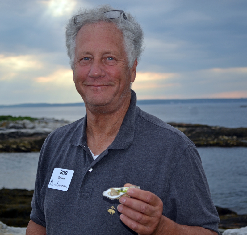 "Bob Zwicker enjoys a Glidden Point oyster during ""An Evening at the Cuckolds Lighthouse"" on Wednesday, July 12. (Abigail Adams photo)"