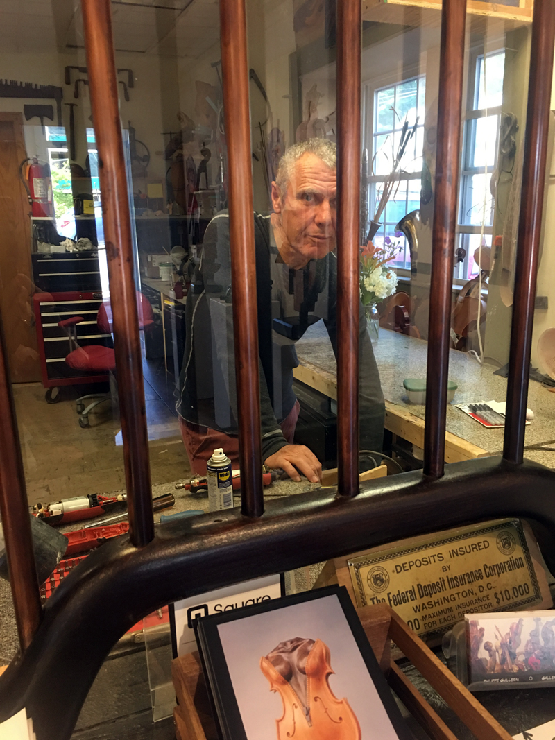 Artist Philippe Guillerm works in his workshop at Philippe Guillerm Gallery in Waldoboro, behind the teller window of the former bank, during ArtWalk Waldoboro, Saturday, July 8. (Christine LaPado-Breglia photo)