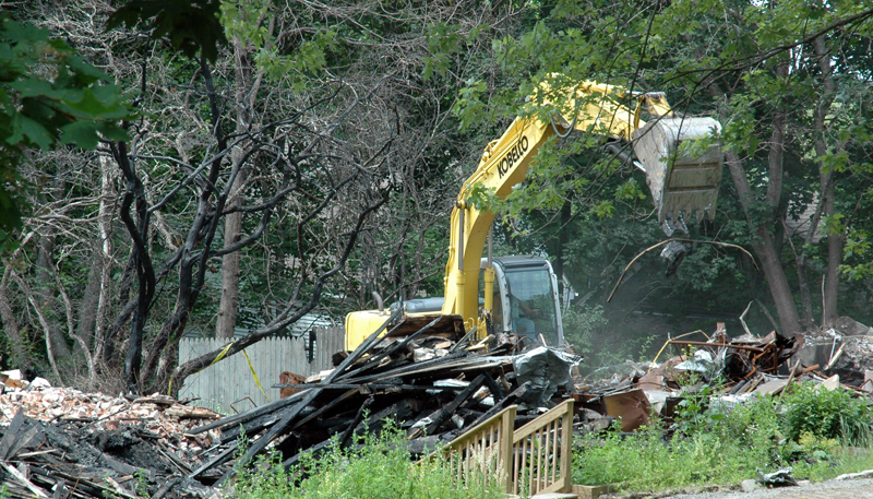 An excavator clears debris at the Reed Mansion site on Glidden Street in Waldoboro the afternoon of Monday, July 10. (Alexander Violo photo)