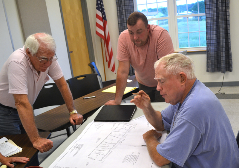 From left: Whitefield Planning Board members Steve Sheehy and Jake Mathews look on as Steve Smith discusses his plans for his Route 17 property during the board's Wednesday, July 19 meeting. (Abigail Adams photo)