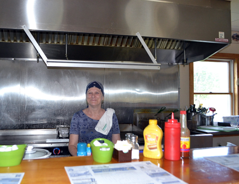 Hunters Breakfast cook Cindy Allen will man the grill for the last time Saturday, July 7, when the restaurant will close its doors after more than 10 years. (Charlotte Boynton photo)
