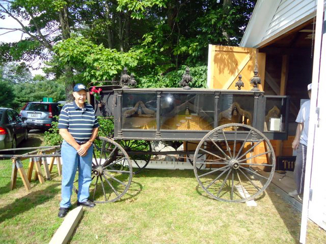 Ralph Bond stands beside his grandfather's 1800s horse-drawn hearse, which will be on display at the Saturday, Aug. 5 open house and exhibit day at the Old Jefferson Town House.