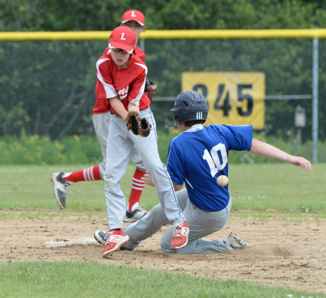 Cooper Waltz attempts to stop a wild throw for the LIons as Aiden Starr steals second for Union Farm Equipment. (Paula Roberts photo)