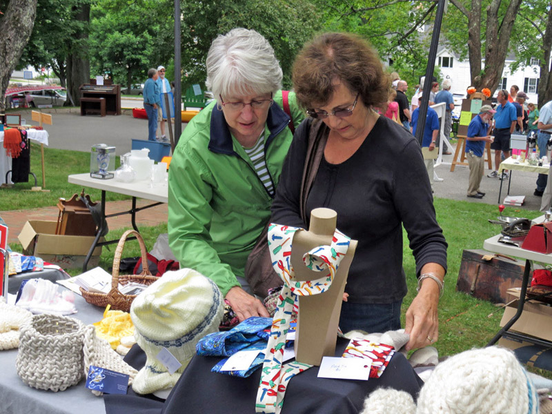 Shoppers check out hand-crafted items made by the Ladies Organ Society.