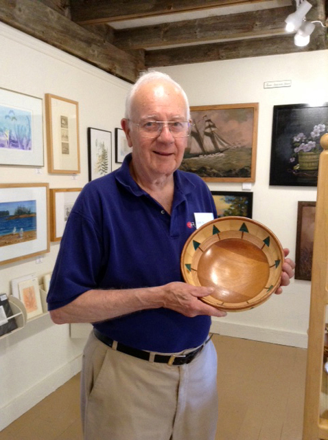 Tom Raymond with a hand-turned bowl.