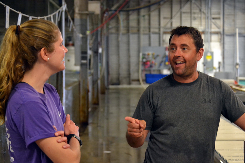 Abby Shaughnessy discusses her research with Curt Brown, UMaine alumnus and a marine biologist at Ready Seafood Co., Portland. (Aliya Uteuova photo)