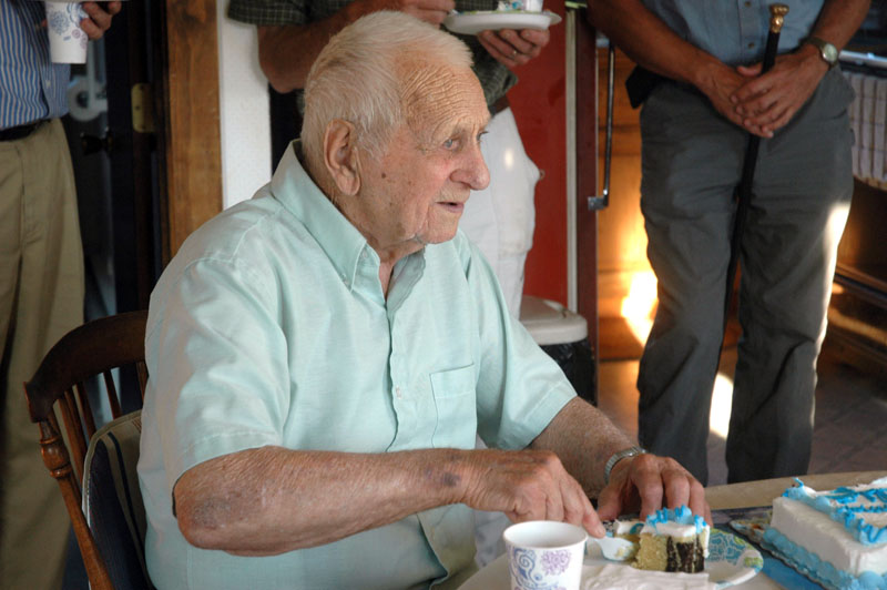 Guilford Hannon digs into a piece of cake during a ceremony honoring him as Bristol's oldest resident. (Alexander Violo photo)