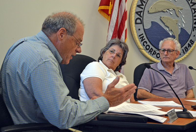 Damariscotta Town Manager Matt Lutkus (left) speaks during the Damariscotta Board of Selectmen's meeting Tuesday, Aug. 1 while Selectmen Robin Mayer and Ronn Orenstein look on. (Maia Zewert photo)