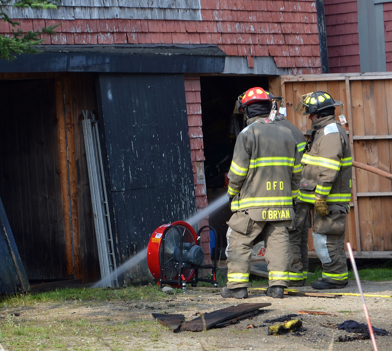 Damariscotta firefighters douse a hot spot in a barn at 23 Biscay Road in Damariscotta the morning of Thursday, Aug. 17. (Maia Zewert photo)