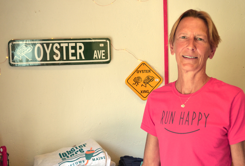 Barb Scully stands with some of the unique products available at Scully's Oyster and Lobster Market on River Road in Edgecomb on Thursday, Aug. 17. (Abigail Adams photo)