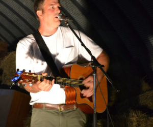 Pittston singer-songwriter Walter Weymouth entertains the crowd gathered in the barn at Sheepscot General the evening of Friday, Aug. 18. (Christine LaPado-Breglia photo)