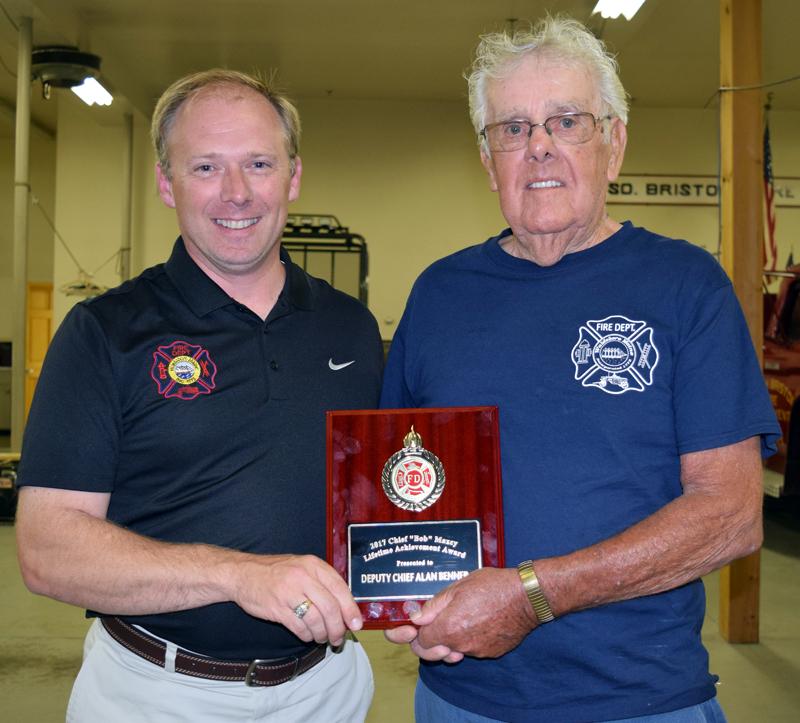 Waldoboro Fire Chief Paul Smeltzer (left) presents the Chief Bob Maxcy Lifetime Achievement Award to former Waldoboro Deputy Fire Chief Allan Benner. (J.W. Oliver photo)