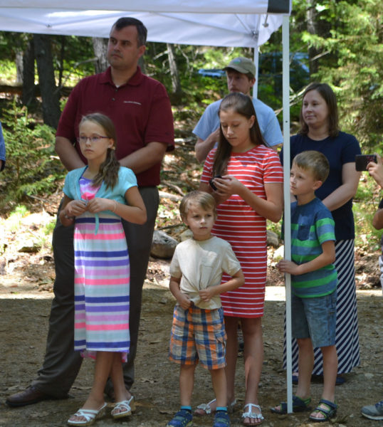 David Seavey, with his wife and six children, traveled from Michigan to represent the Segerstrom family at the ribbon-cutting ceremony for the Carl and Barbara Segerstrom Preserve at Squam Creek. (Charlotte Boynton photo)