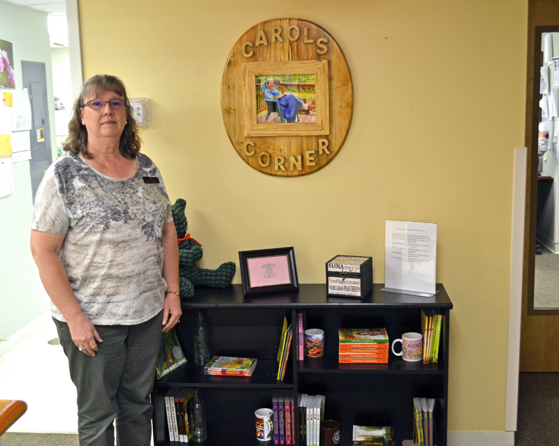 Julie Bailey stands in Carol's Corner on Tuesday, Aug. 15. Carol's Corner offers free books to the Sheepscot Valley Health Center's young patients. (Abigail Adams photo)