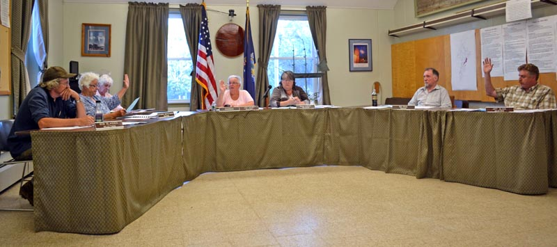 The Wiscasset Board of Selectmen votes to hold an open special town meeting to reconsider the planning department budget Tuesday, Aug. 1. From left: Selectmen Bob Blagden and Katharine Martin-Savage, recording secretary Jackie Lowell, Chair Judy Colby, Town Manager Marian Anderson, and Selectmen Ben Rines and Jeff Slack. (Abigail Adams photo)
