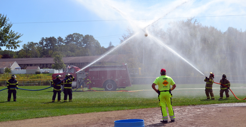 The Newcastle Fire Department battles York Beach in the waterball competition during the muster at the 54th Maine State Federation of Firefighters Convention in Boothbay Harbor. (Abigail Adams photo)