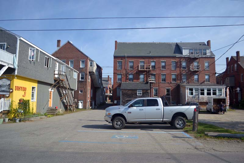 Damariscotta plans to start construction of public restrooms on the site of this parking area and to make improvements to nearby Taco Alley in spring 2018. (Maia Zewert photo)