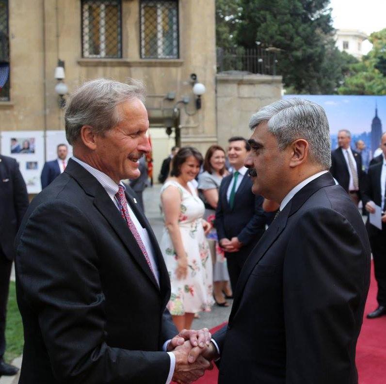 U.S. Ambassador Robert Cekuta (left) greets Azerbaijan Finance Minister Samir Sharifov at the U.S. Embassy in Azerbaijan during the embassy's Fourth of July celebration. (Photo courtesy Robert Cekuta)