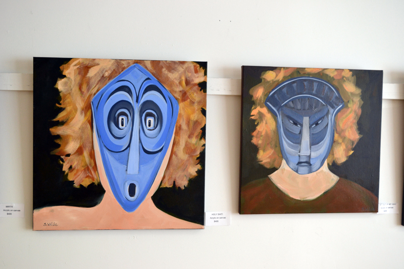 Two of the six paintings in Sarah Wilde's masks series in the West Gallery of River Arts. (Christine LaPado-Breglia photo)