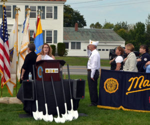 Boothbay Region High School senior Jackie McLoon, of Boothbay Harbor, sings the national anthem during the groundbreaking for a new POW/MIA memorial at The American Legion's state headquarters in Winslow on Friday, Sept. 15. (Charlotte Boynton photo)