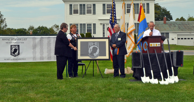 State American Legion Cmdr. Randall Kluj (right) explains the design of the POW/MIA flag during the groundbreaking ceremony for a POW/MIA memorial at the Legion's state headquarters in Winslow. From left: state American Legion Auxiliary President Ann Durost, American Legion Riders State Director Kaye Bouchard, and Sons of the American Legion National Executive Committeeman David Raymond. (Charlotte Boynton photo)