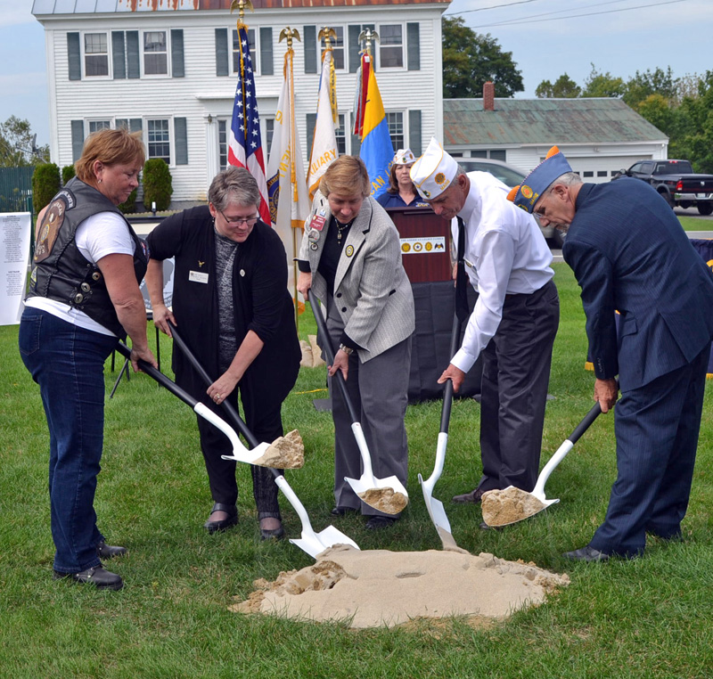 American Legion leaders break ground for the POW/MIA memorial at state headquarters in Winslow on Friday, Sept. 15. From left: American Legion Riders State Director Kaye Bouchard, state American Legion Auxiliary Department of Maine President Ann Durost, American Legion Auxiliary National President Diane Duscheck, and Sons of the American Legion National Executive Committeeman David Raymond. (Charlotte Boynton photo)