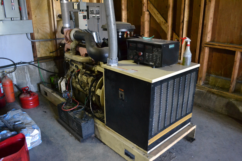One of the Monhegan Plantation Power District's three old diesel generators remains on standby after the district's upgrade to a microturbine system. (Maia Zewert photo)