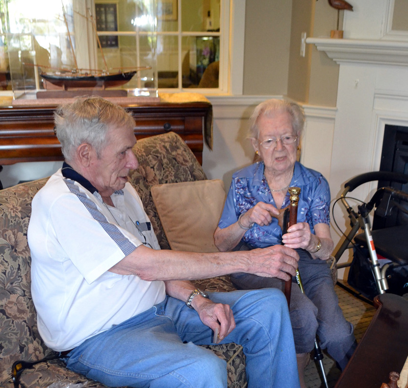 "Westport Island First Selectman George Richardson Jr. presents the town's Boston Post Cane to Elizabeth ""Betty"" Pierce during her 100th birthday party at Chase Point Assisted Living in Damariscotta on Sept. 26. (Charlotte Boynton photo)"