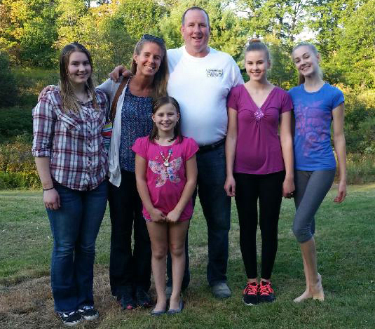 The Pagurko family gathers Saturday, Sept. 23 to celebrate surviving a house fire earlier in the month. From left: Anna, Melanie, Christina, John, Calista, and Shae-Lynn. (Photo courtesy the Pagurko family)