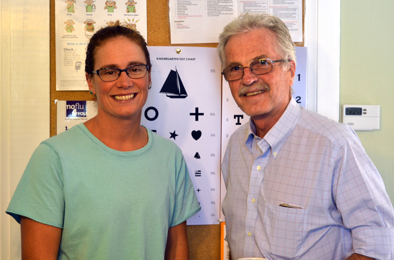 Wiscasset Family Medicine's new owner, Dr. Cortney Linville, stands wiith practice founder Dr. Edward Kitfield in their office on Water Street in Wiscasset on Wednesday, Sept. 13. (Abigail Adams photo)