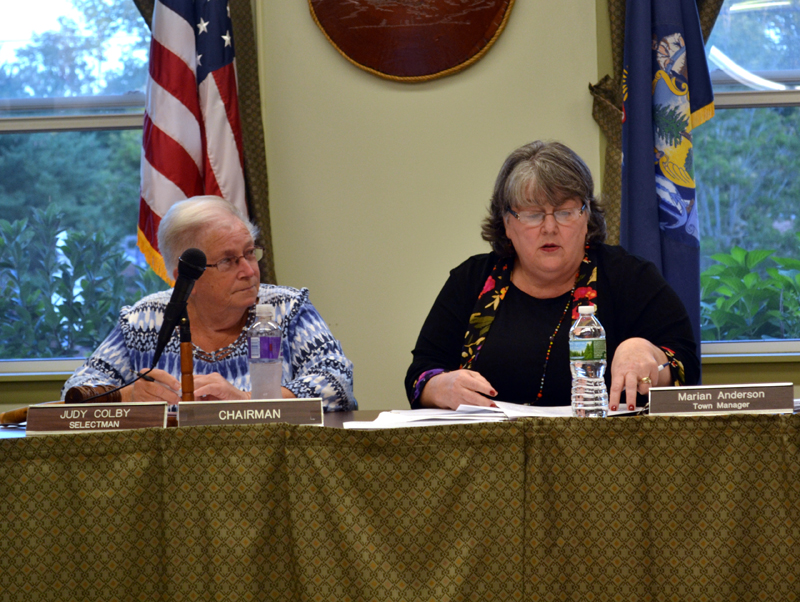 Wiscasset Town Manager Marian Anderson (right) reads a citizen's petition to transfer planning funds to surplus Tuesday, Sept. 12 as Wiscasset Board of Selectmen Chair Judy Colby looks on. (Abigail Adams photo)