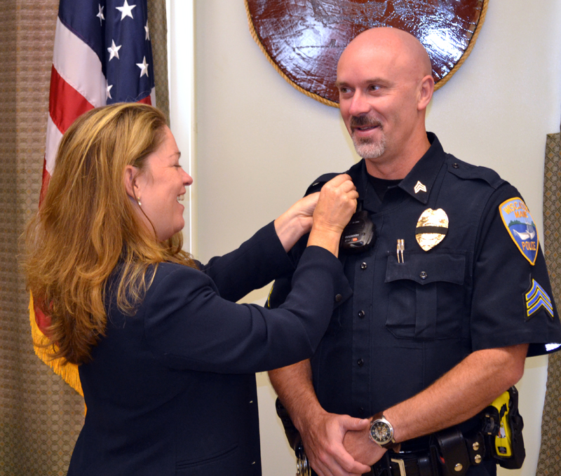 Dr. Margaret Marcone pins chevrons onto Wiscasset Police Department Sgt. Craig Worster's uniform during Worster's swearing-in ceremony Monday, Sept. 11. (Abigail Adams photo)