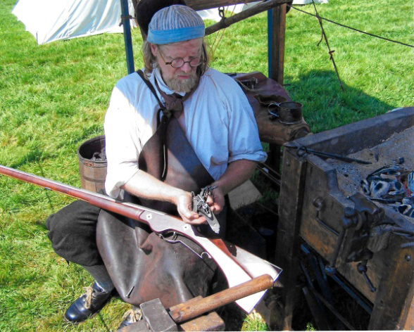 Jeffrey Miller works on a wheellock musket at Colonial Pemaquid State Historic Site.