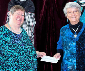 Women of Substance owner Lynne Urquhart (right) presents a donation from the store's Rounding Down program to New Hope for Women Executive Director Kathleen Morgan.