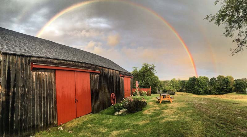 Kristin Orne's photo of a double rainbow over a barn in Bristol received the most votes to become the ninth monthly winner of the #LCNme365 photo contest. Orne will receive a $50 gift certificate from Renys, the sponsor of the September contest.